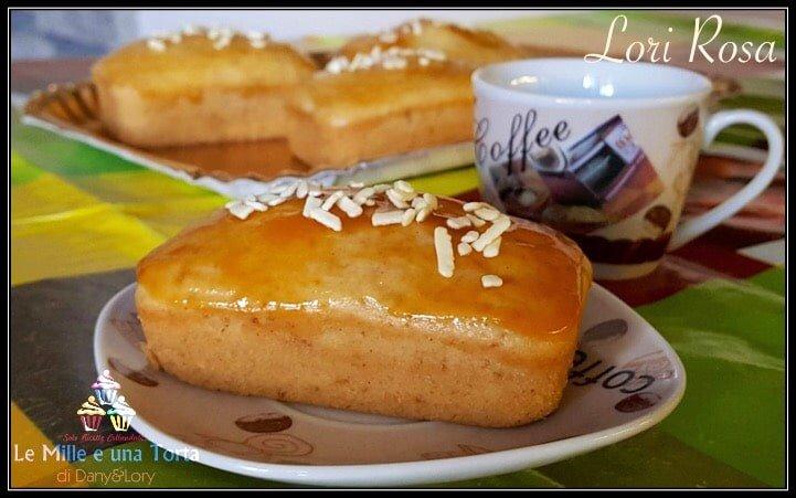 MINI PLUMCAKE ALLO YOGURT SENZA UOVA E SENZA BURRO, CON IL BIMBY  RICETTA DI: LORI ROSA  Ingredienti:  140 g farina 1 30 g frumina 170 g yogurt bianco 70 g zucchero di canna 65 ml olio di semi 1/2 bustina lievito per dolci marmellata di albicocche qb per spennellare e scaglie